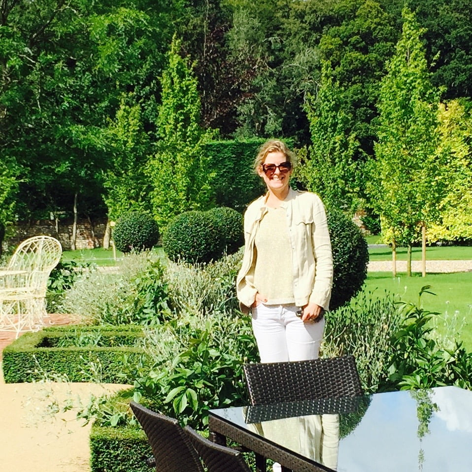 Jo Aldertson Phillips in a French style garden she designed in Oxfordshire
