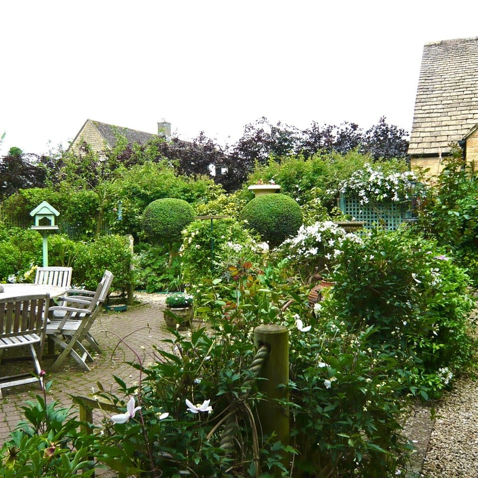 This is the 'dining room' within this traditional Cotswold garden I designed 10 years ago.