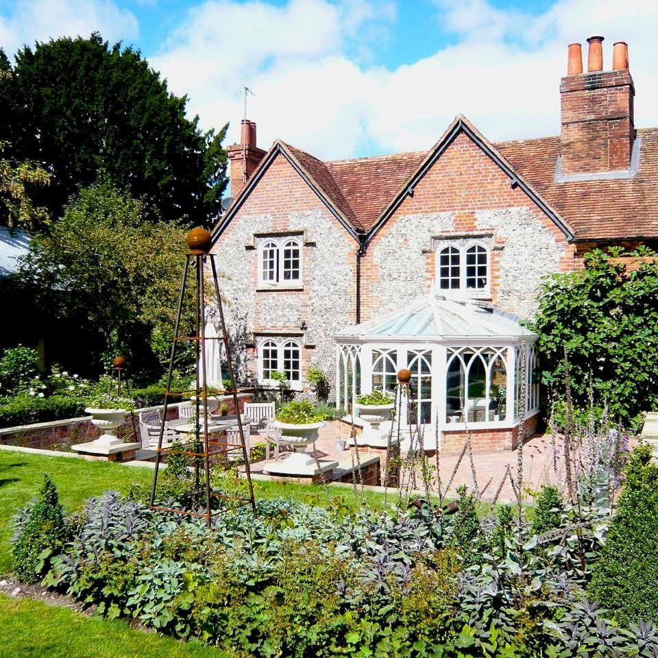 Classic brick & flint cottage with large new terrace & pretty planting by Jo Alderson Phillips