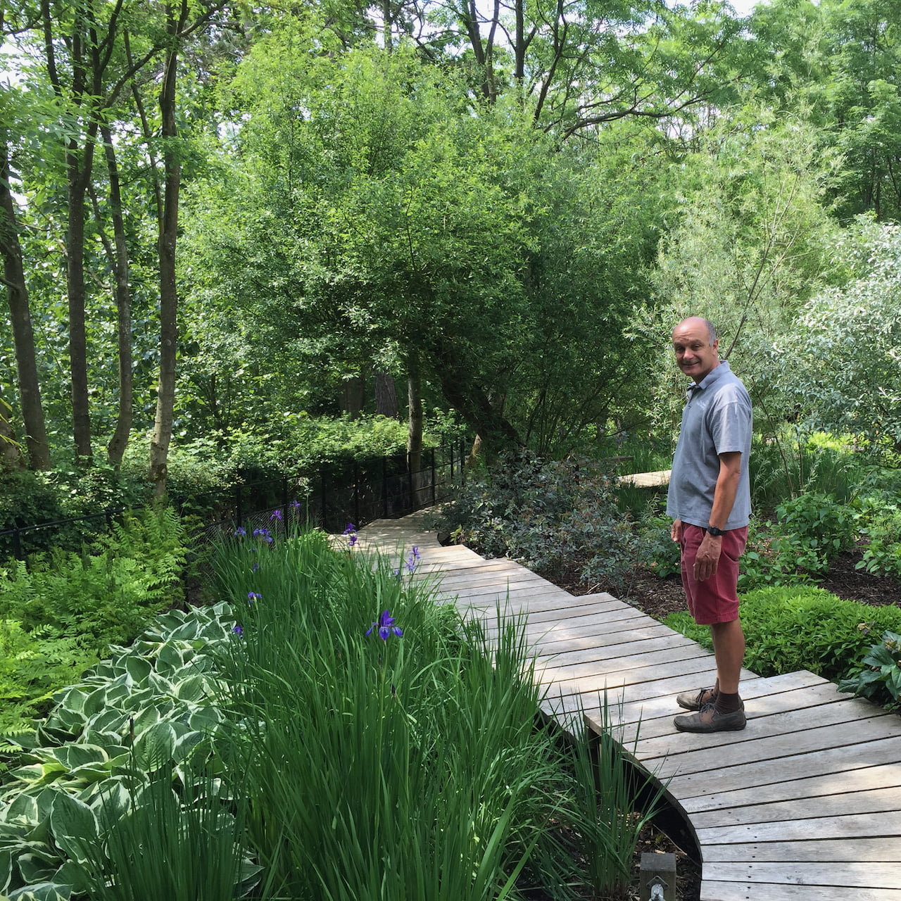 the boardwalk over the bog garden in this large Buckinghamshire garden. This is Rob who built it