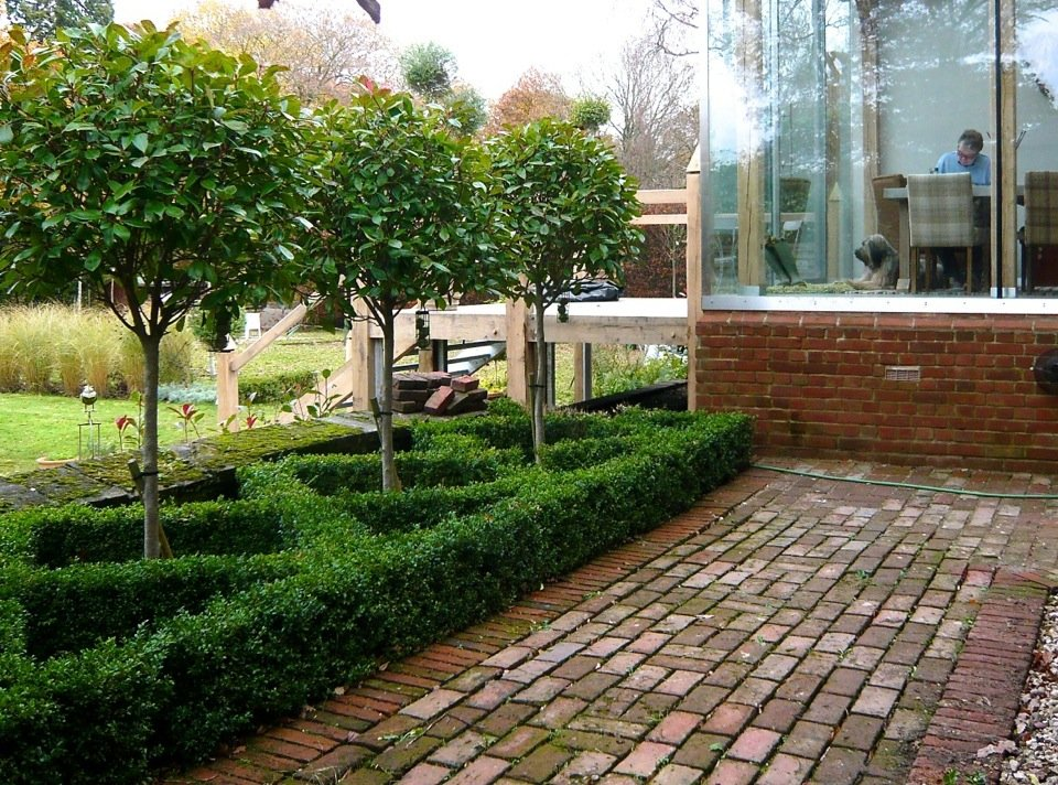 small formal knot garden in a courtyard by jo alderson