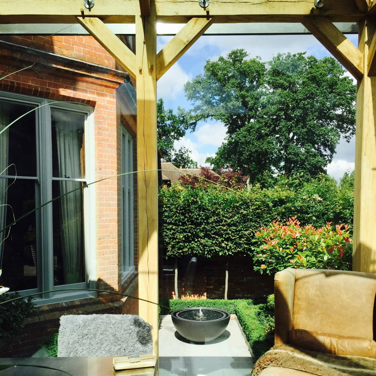 This is the view from inside our oak framed dining room looking out to our formal courtyard garden