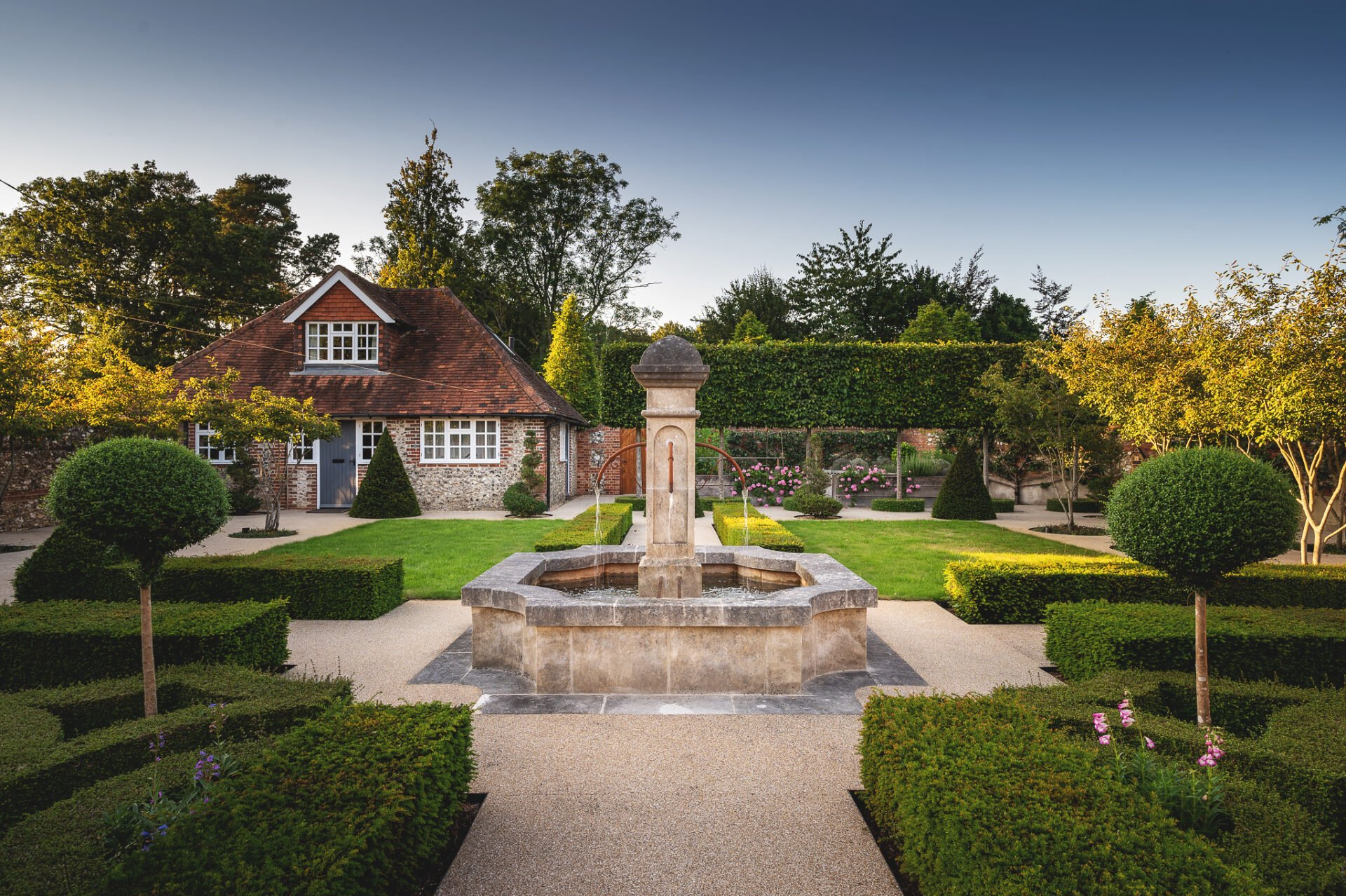 Walled garden with stone fountain