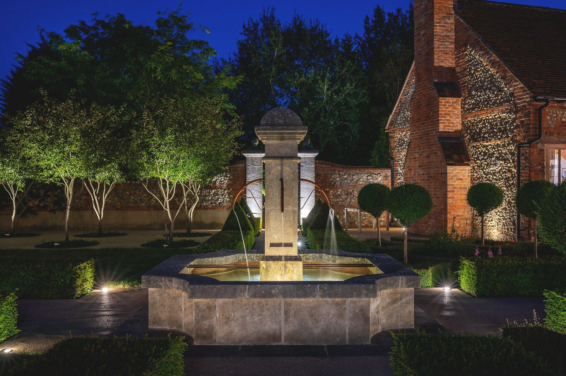 Fabulous walled garden with fountsin in French style by Jo Alderson Phillips