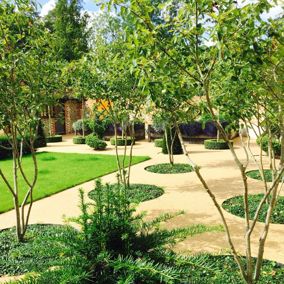 walled-garden with Amelanchier trees