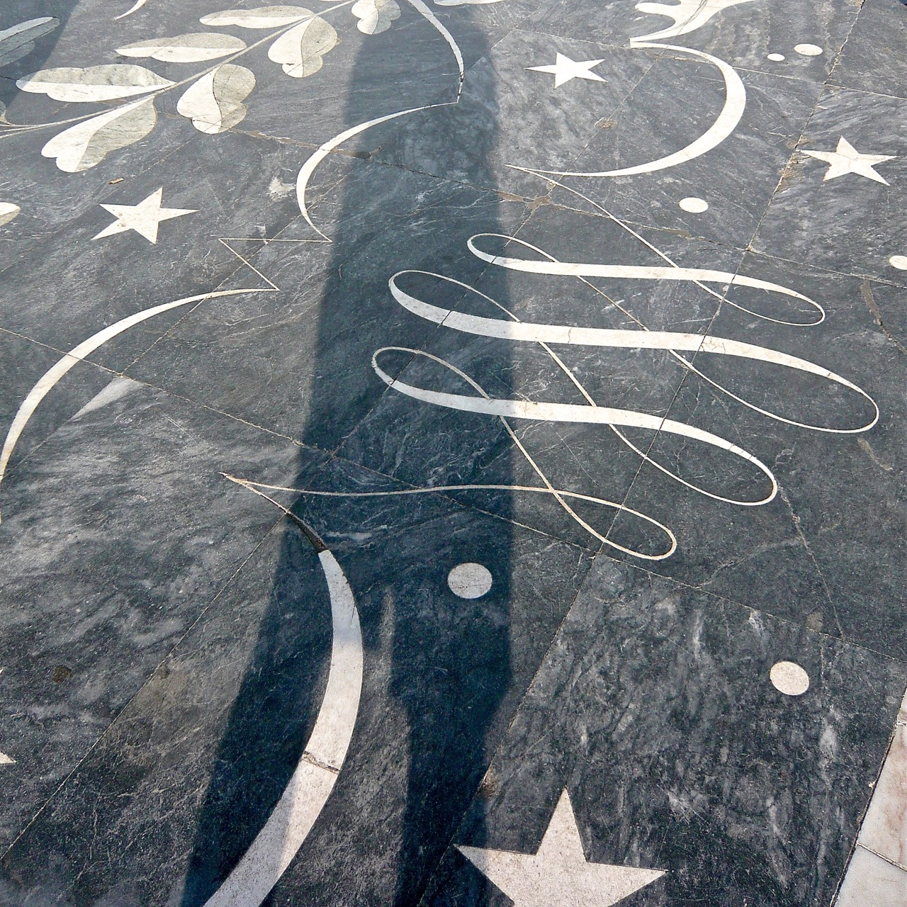 swirling elegant inlay in Portugese pavement - blog by Jo Alderson Phillips of Joanne Alderson Design