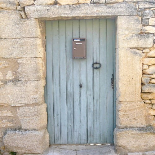 This blue door looks wonderful against the raging stone. I took this photo in Provence & just loved these simple understated entrances