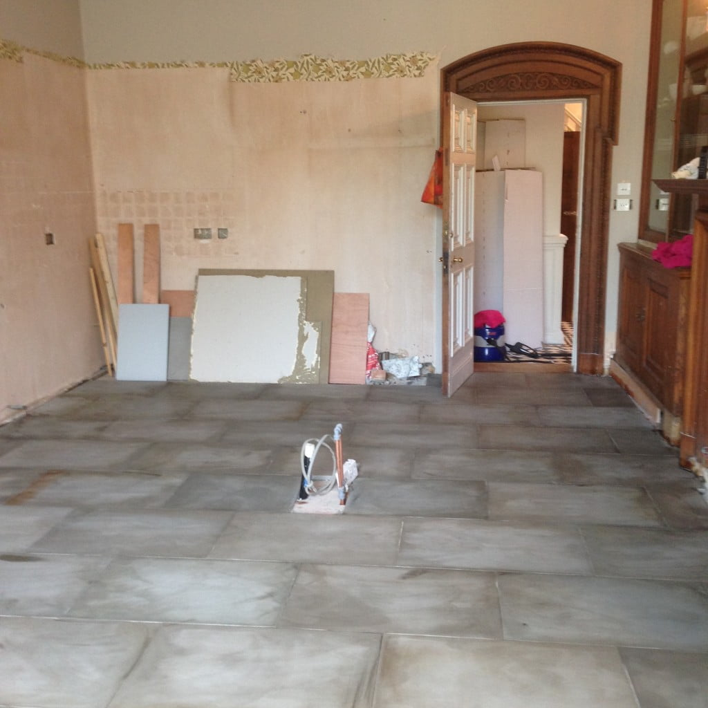 We transformed the kitchen at our Victorian house near Newbury. Here we'd just sealed the new stone floor. As you can see I don't just design gardens!