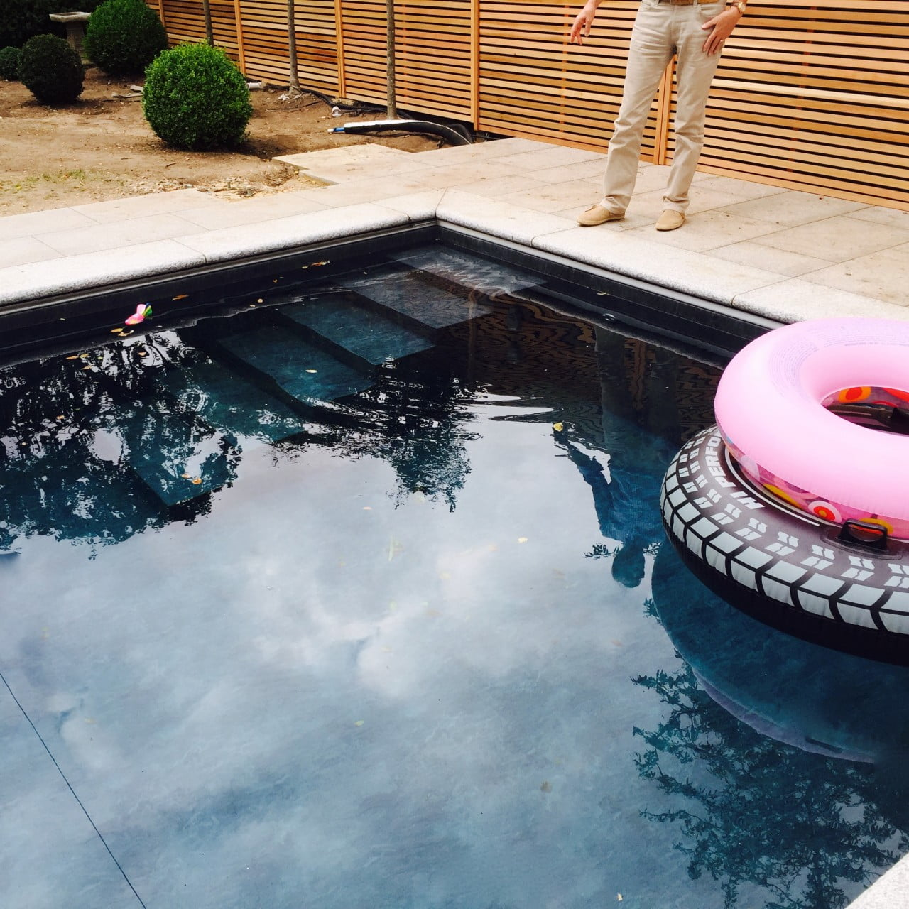 Here is the contemporary swimming pool with a slate grey liner. It looks very smart in this minimal design
