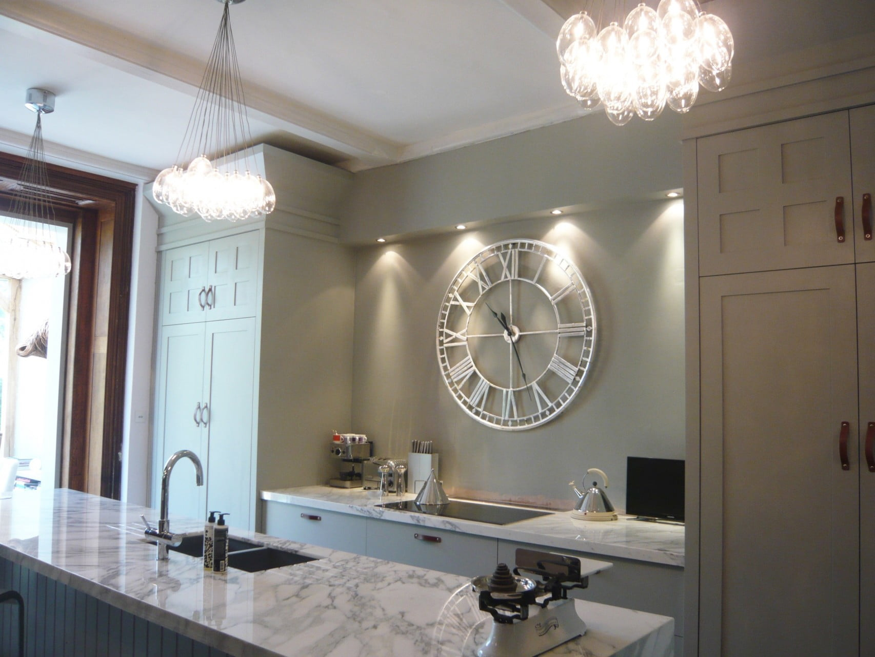 I redesigned our kitchen to make the most of the tall ceilings & to reflect the Victorian house we live in. It's contemporary - not pastiche