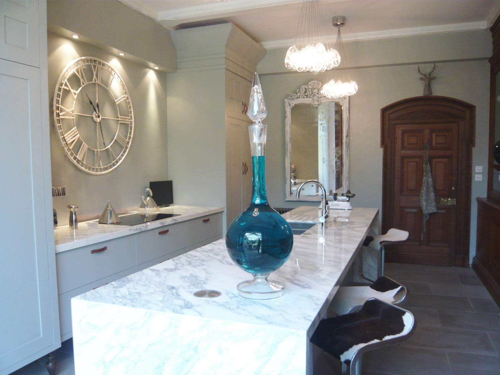 We redid the kitchen of our Victorian house & here it is now complete. We used marble & stone & clusters of globe lights . I don't just design gardens!