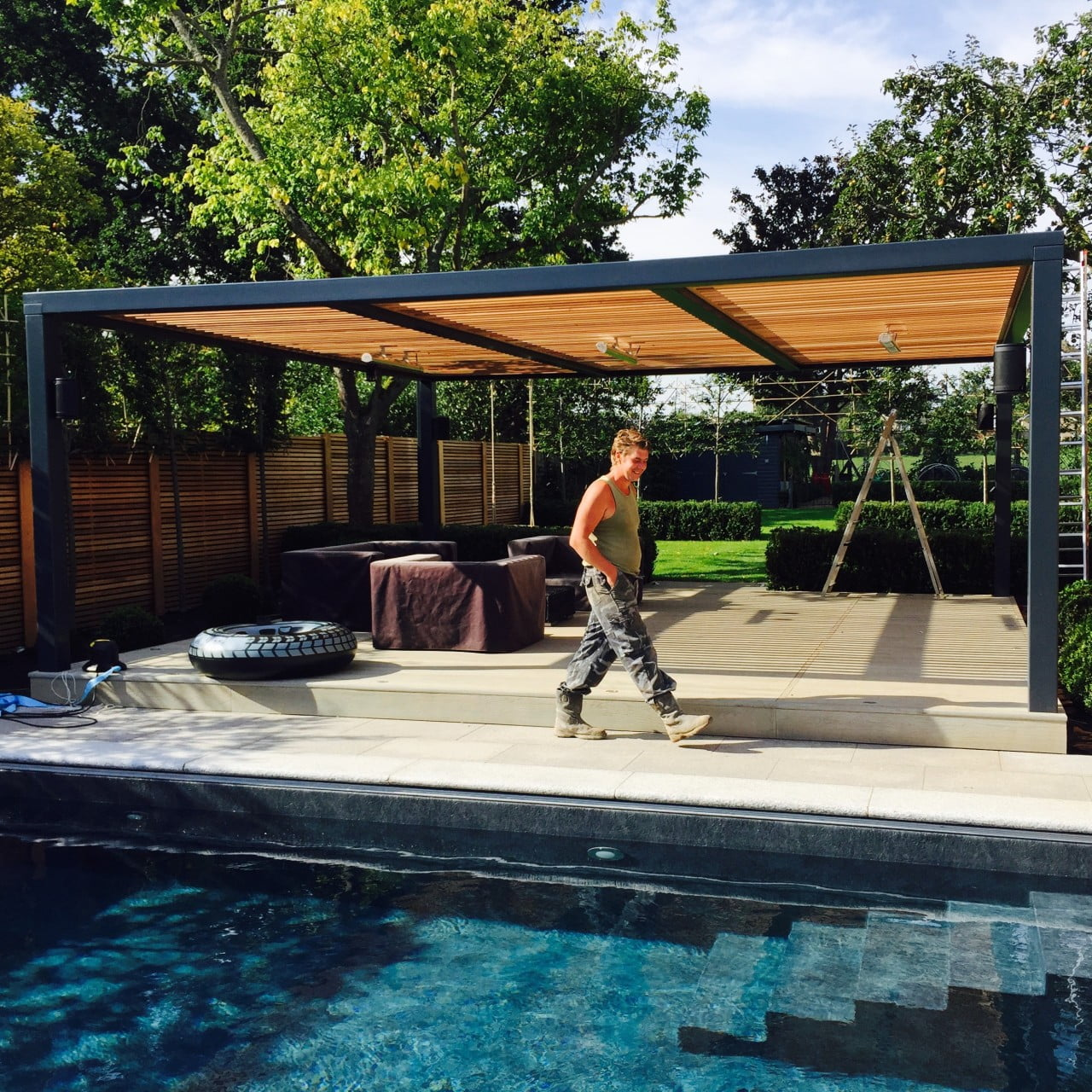 This is one of the team who built this contemporary garden with swimming pool I designed in Berkshire