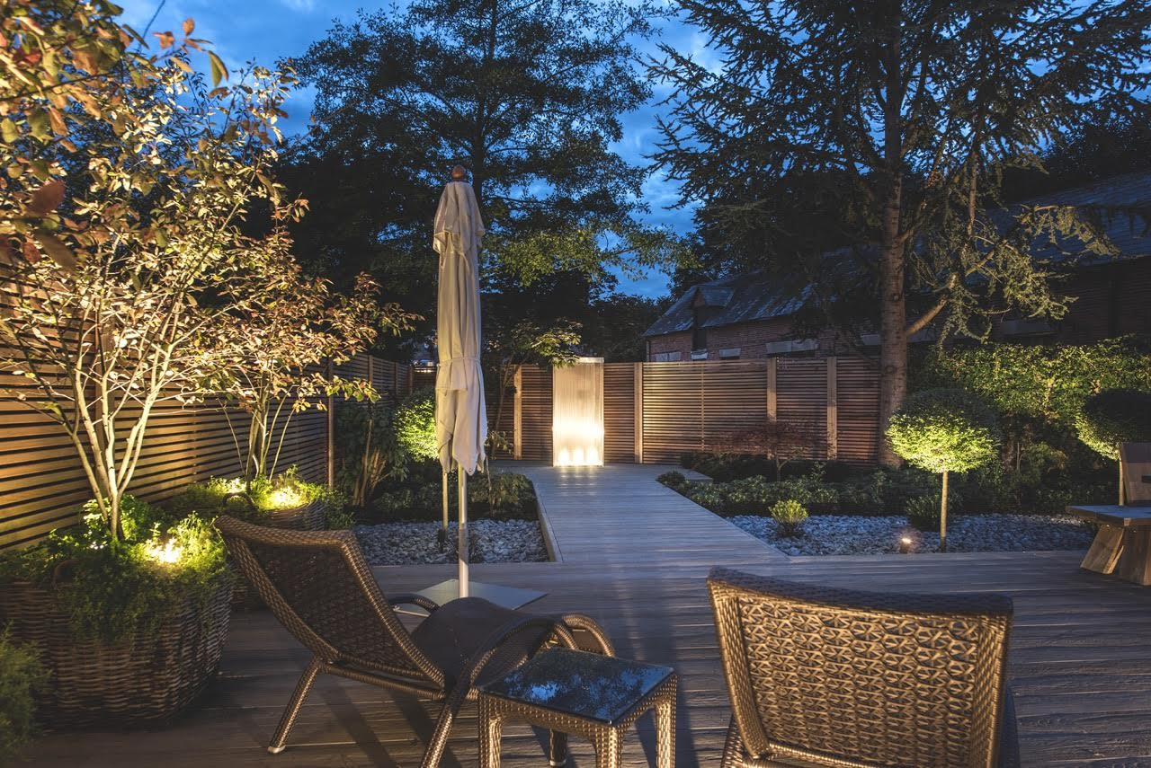 lighting in this modern garden design for a barn conversion