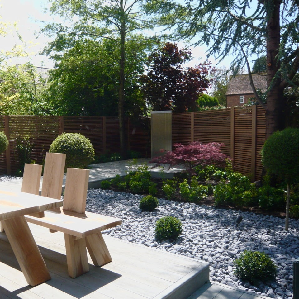 Pretty acers & boardwalk in this modern garden design with water feature & cedar strip fencing