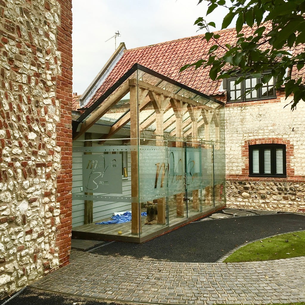 This is a glass box & oak framed extension by Igloo. I designed the text & installed t for my client