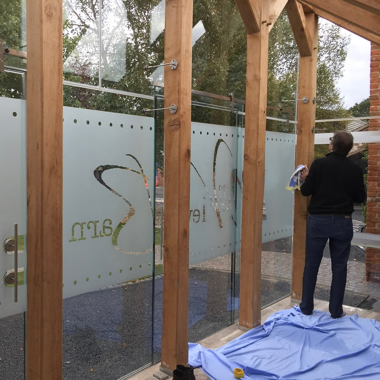 Here we are installing the etched glass name for my clients porch