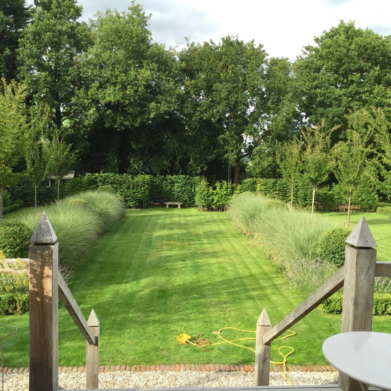 A view of our own garden here in newbury. It is a large formal garden with evergreen topiary & ornamental cherry trees