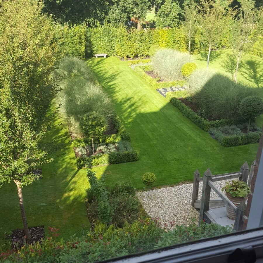 This is my own formal large garden here in Newbury Berkshire. We have lines of cherry trees & formal beds with ornamental grasses & topiary