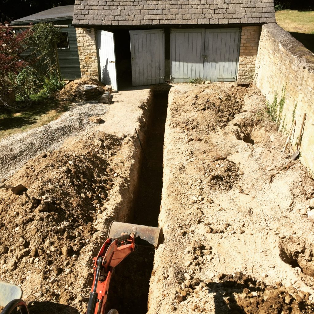 This trench marks the foundation line for the extension leading from our barn along this Cotswold wall & to what will become my  new studio