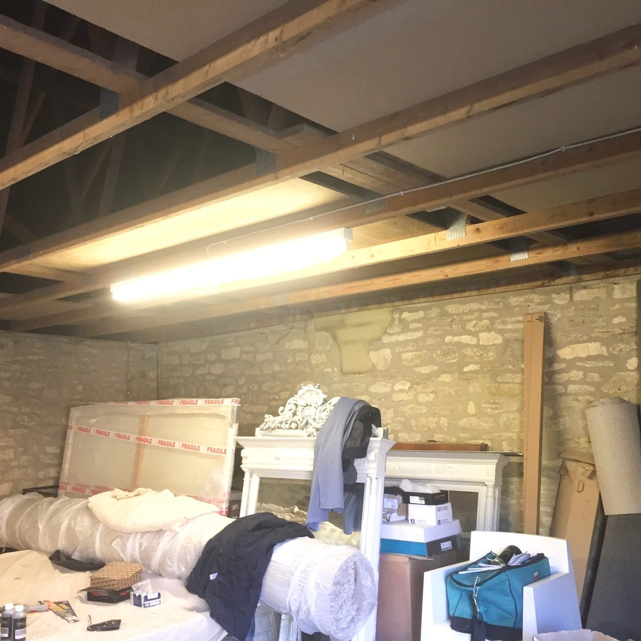 the original interior of the garage with all our junk