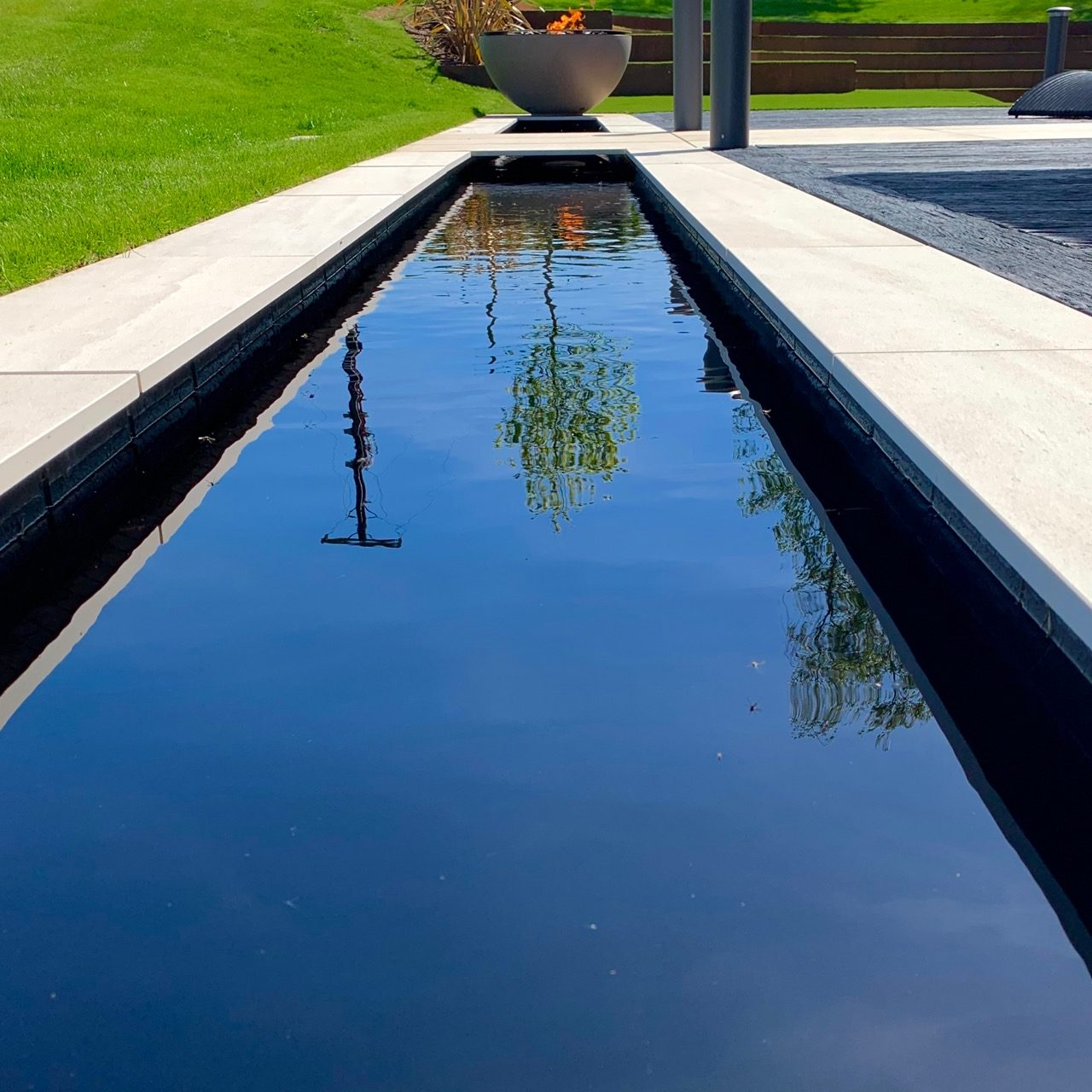 Great reflection pool in a contemporary Cotswold garden by Jo Alderson Design