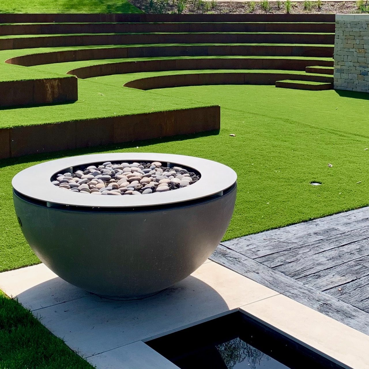 great fire burner in this contemporary Cotswold garden I designed for my clients that melds rural with modern architectural styling. Garden designed by Jo Alderson Phillips