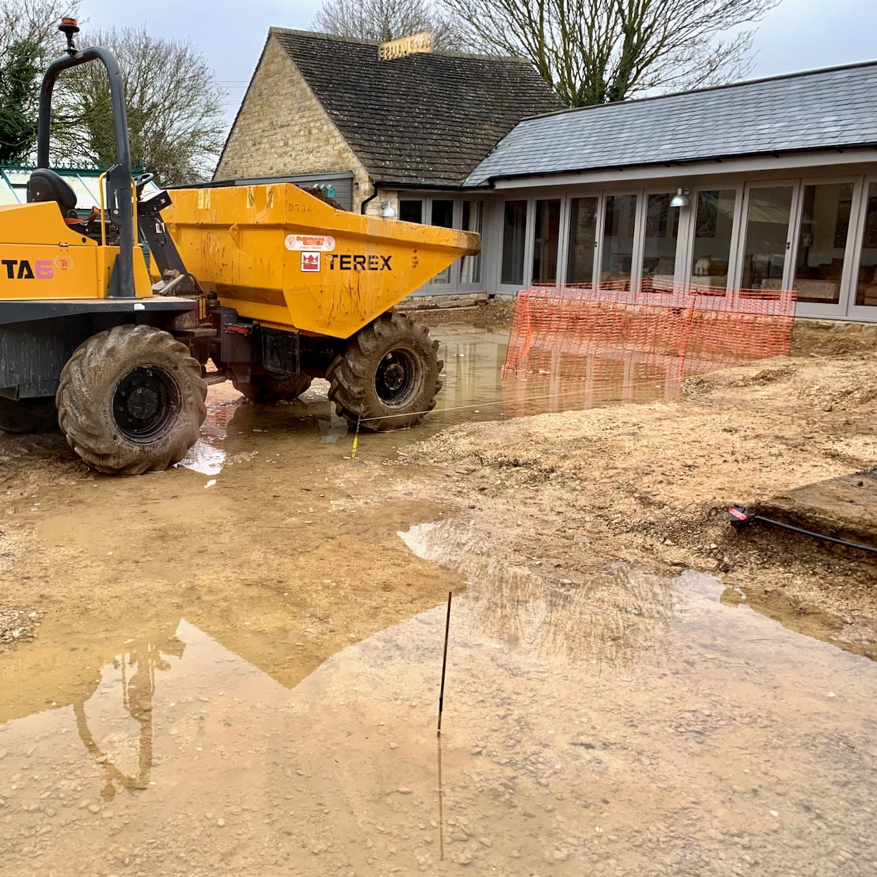 Building work has started at Manor Farm Barn but the water table is so high we have a flood