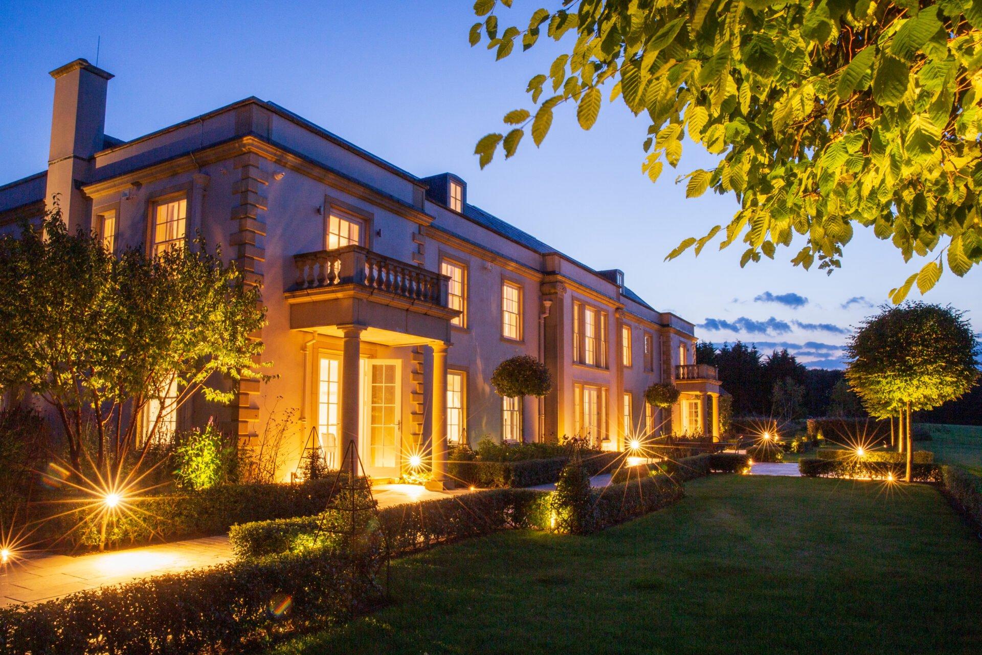 Rear terraces in formal garden beside Georgian house