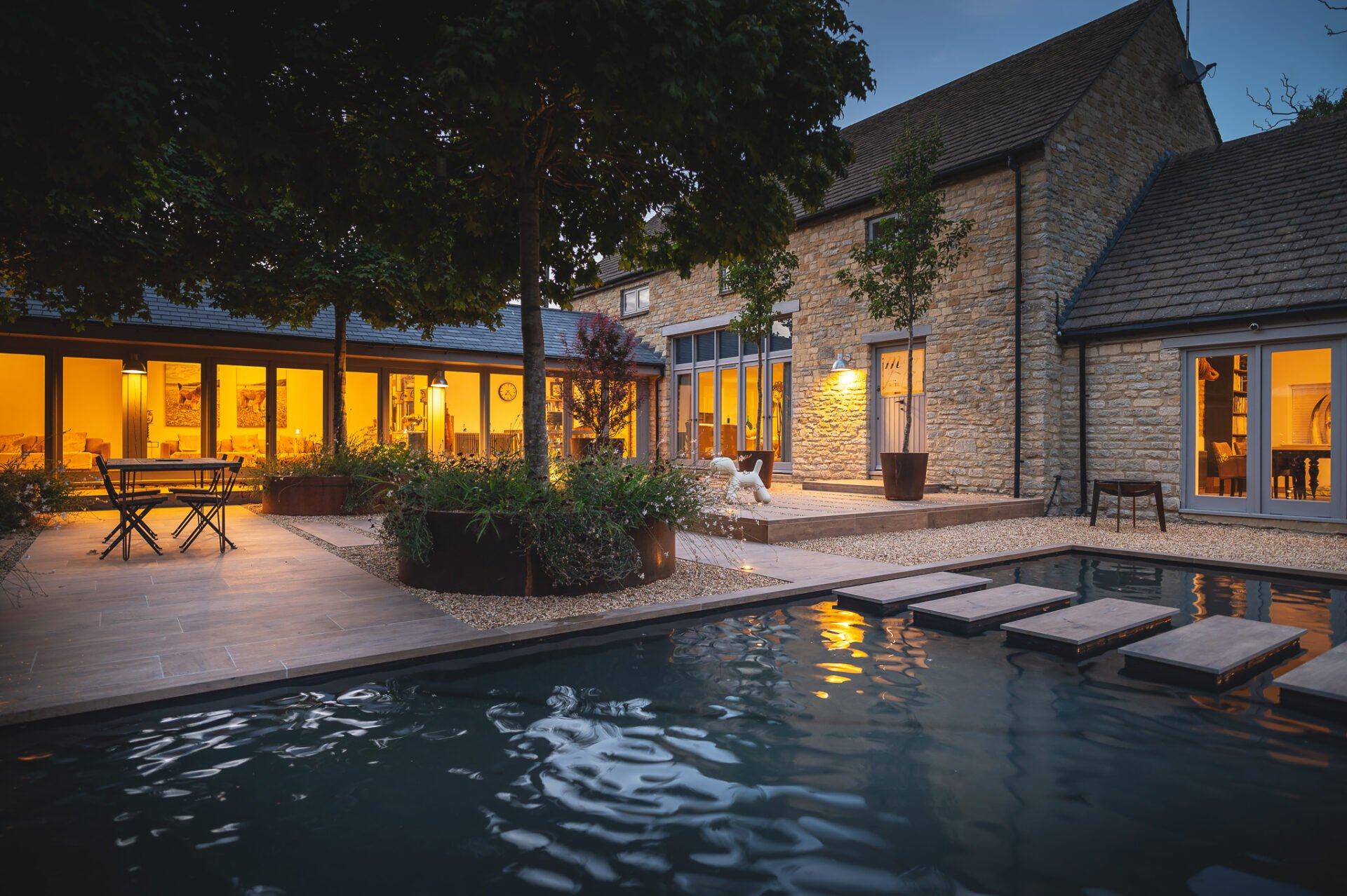 Cotswold stone barn conversion with courtyard by Jo Alderson Phillips
