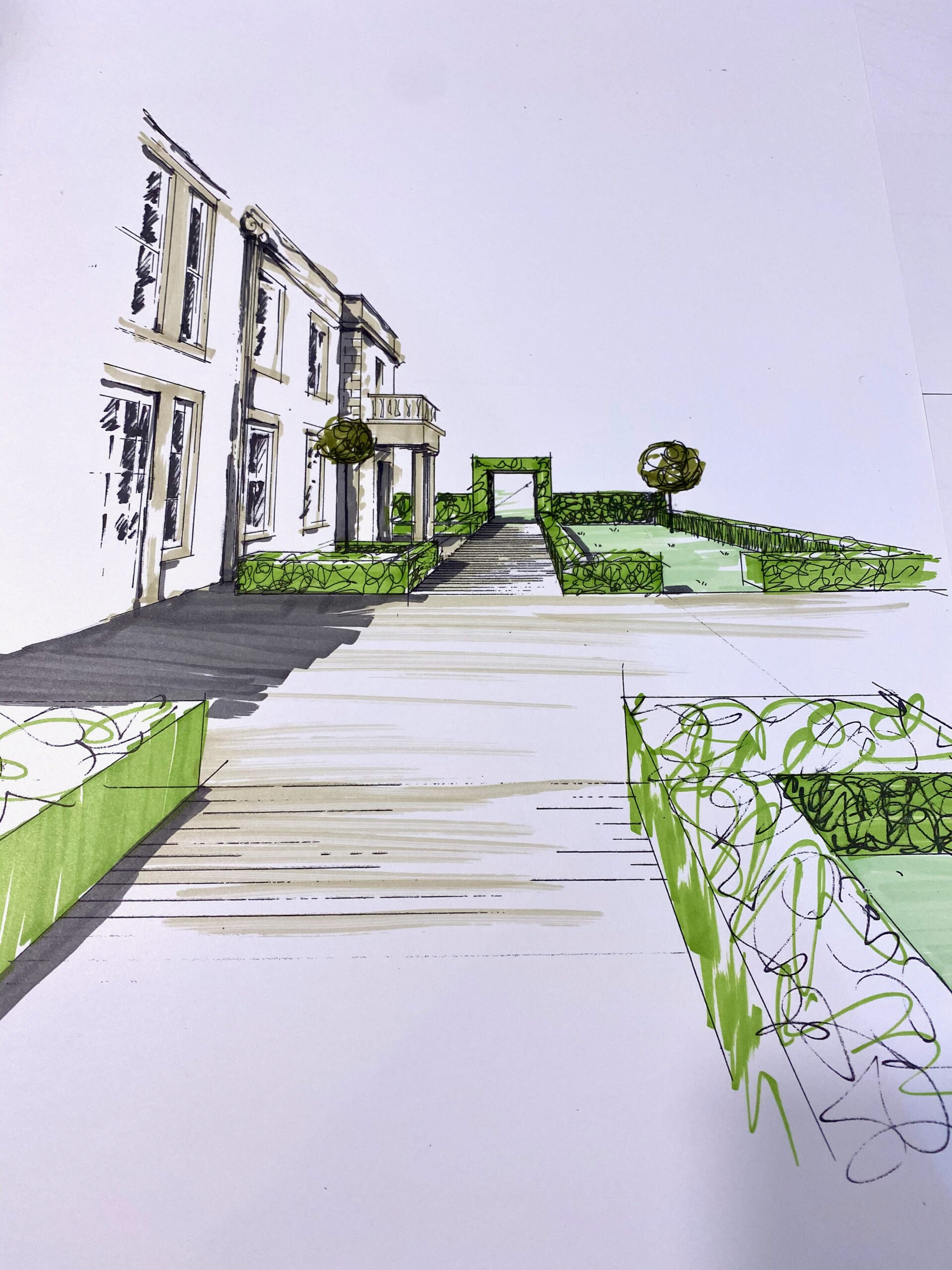 sketching out the rear terrace of a large Georgian house in Buckinghamshire